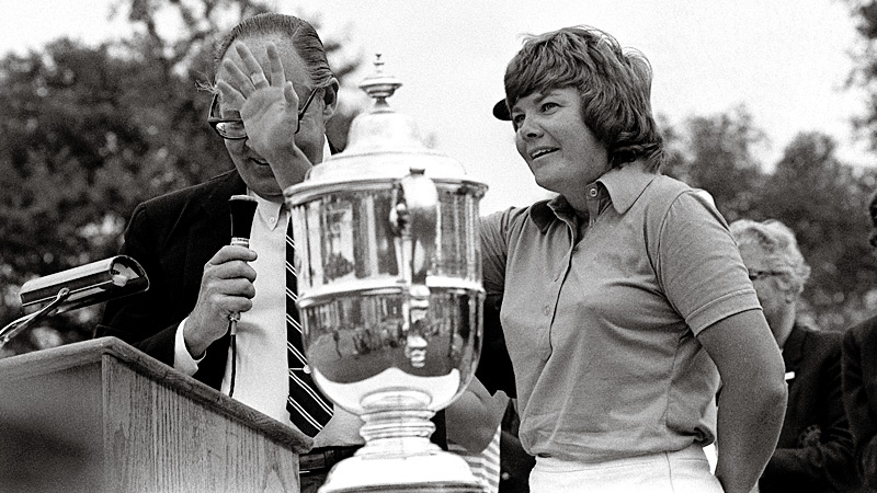 Sandra Haynie accepting a trophy at an LPGA event